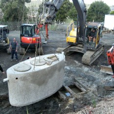Excavator machinery installing grease trap