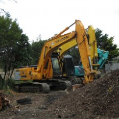 Excavator machinery ready to work at Silverdale Yard